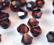 Bicone facetterade kristaller 6mm - Burnt Amethyst